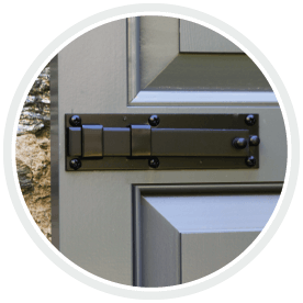 Adorned Openings shutter lock installed on raised panel shutter crafted from composite wood material