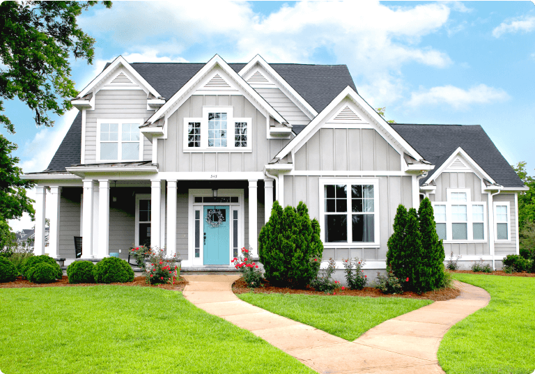 light gray exterior home with modern sized windows and baby blue front door