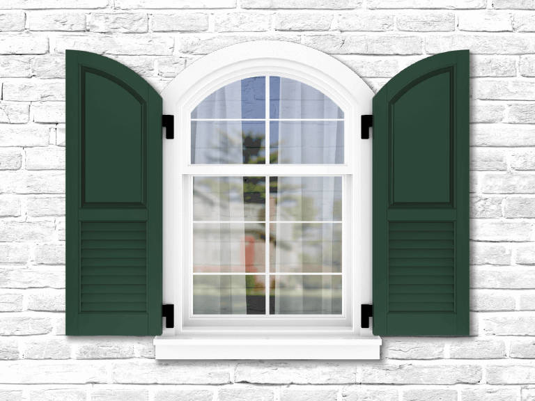 white brick home with green panel shutters