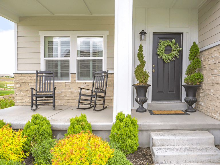 how to use plants to style your home's front entrance